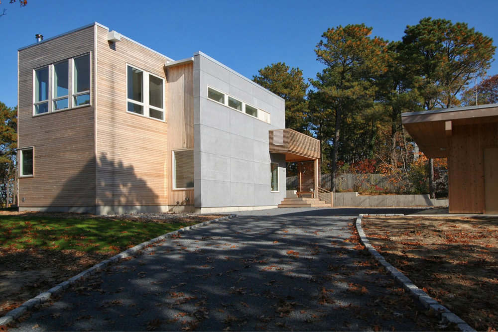 Modern Modular Prefab Peconic Bay House | Shinnecock Hills Hamptons New York | Cedar Cement Board Siding White Windows Deck Cedar Screen Rail | RES4