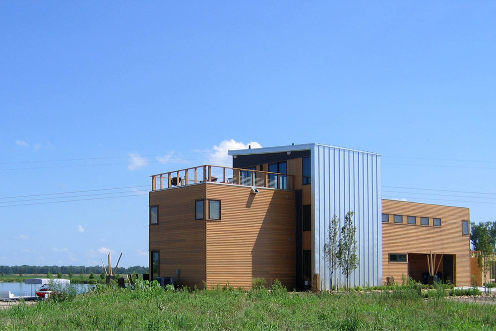 Modern Panelized Prefab Sandy Lake House | Ashland Nebraska | Cedar Siding Metal Panel Roof Deck Strip Windows | RES4