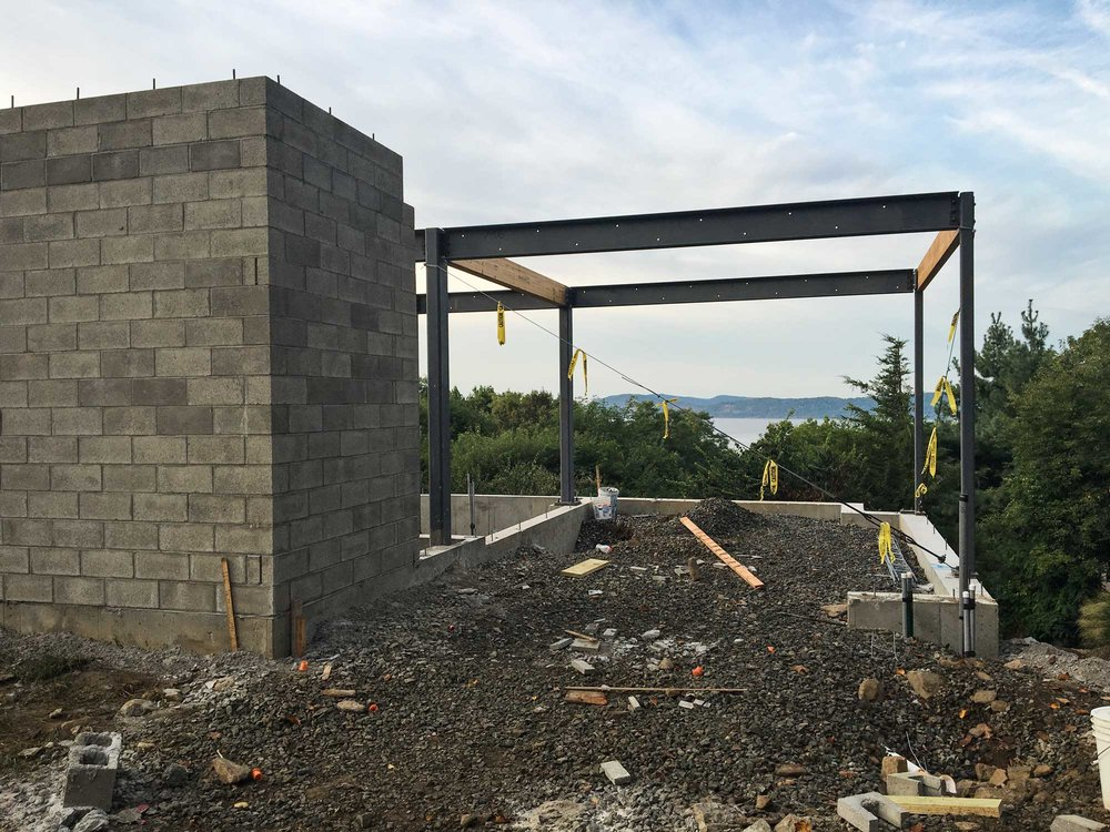 Carport & Entry  --  The future driveway will slide below the house and frame a fantastic view of the Hudson River beyond.