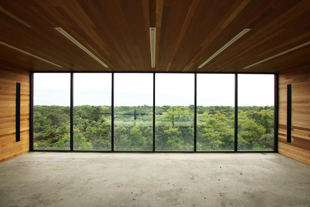 res4-resolution-4-architecture-modern-modular-house-prefab-amagansett-addition-garage-interior-view.jpg