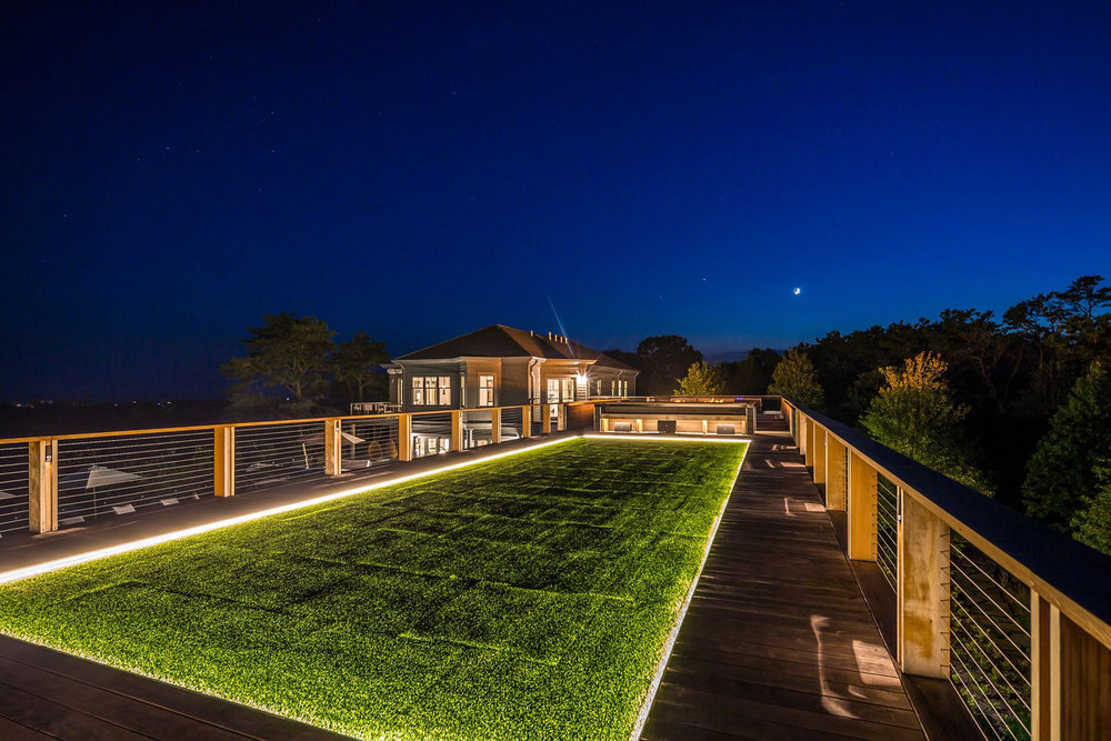 19-res4-resolution-4-architecture-modern-modular-house-prefab-amagansett-addition-exterior-rooftop-garden-lounge-night.jpg