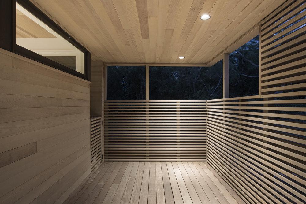 13-res4-resolution-4-architecture-modern-modular-house-prefab-home-north-fork-bluff-house-exterior-entry-foyer-dusk.jpg