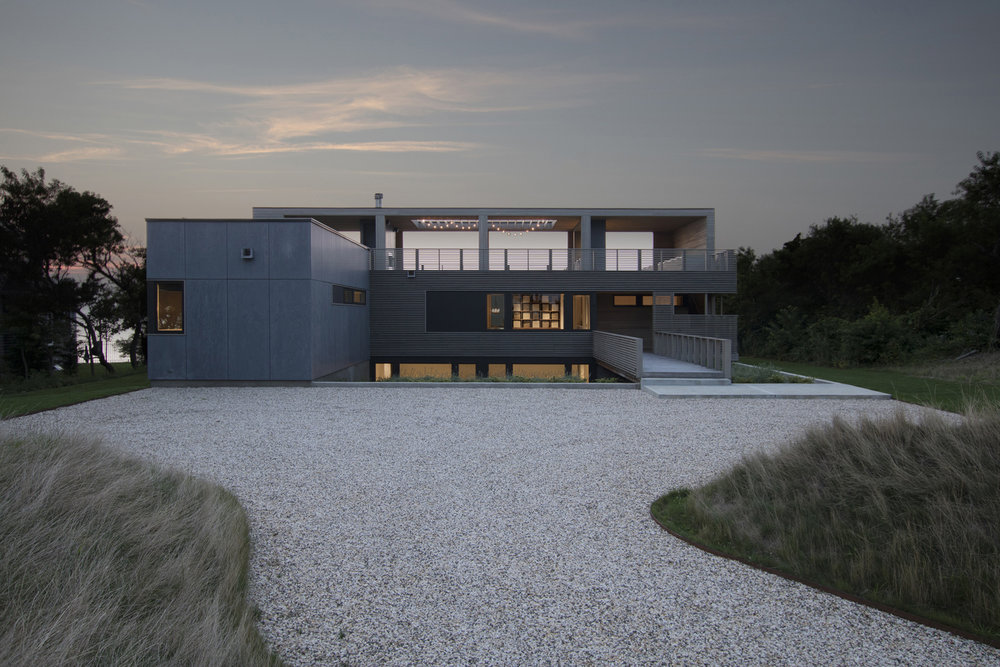 12-res4-resolution-4-architecture-modern-modular-house-prefab-home-north-fork-bluff-house-exterior-facade-elevation-dusk.jpg