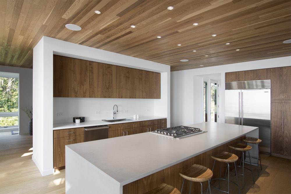 15-res4-resolution-4-architecture-modern-modular-house-prefab-home-north-fork-bluff-house-interior-kitchen-island-millwork.jpg