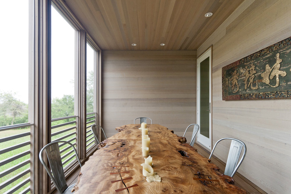 15-res4-resolution-4-architecture-modern-modular-home-prefab-house-fishers-island-exterior-dining.jpg