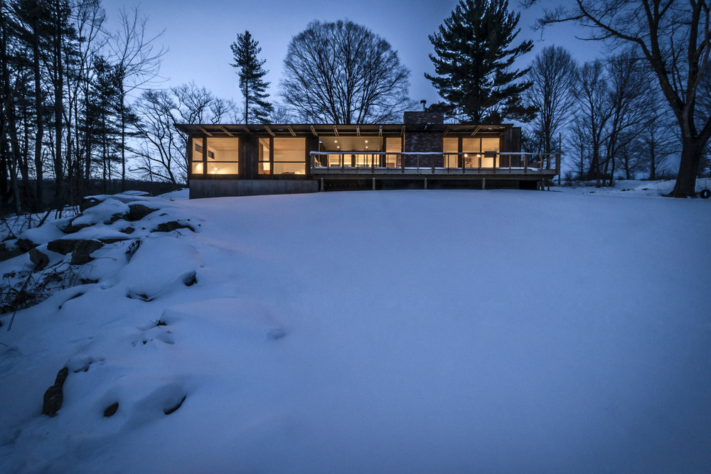09-res4-resolution-4-architecture-modern-modular-prefab-home-cornwall-cabin-exterior-winter-night.jpg