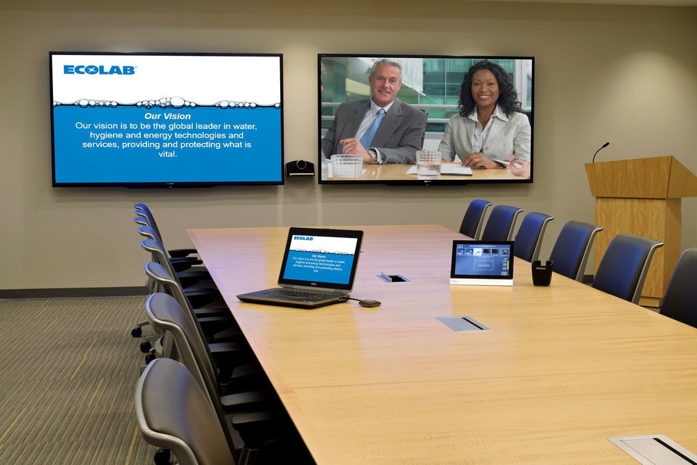 Conference room with video conferencing, integrated sound system and wireless collaboration.
