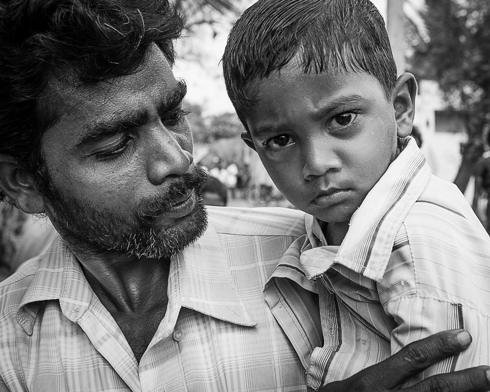 A father in the village with his darling son. You could see the fathers hopes and dreams in the way he looked at his child.