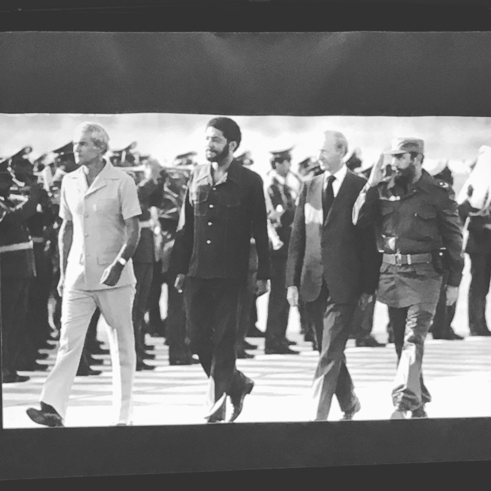 "A photograph of Michael Manley, Maurice Bishop, Pierre Trudeau and Fidel Castro that was part of a slide show on display at ""The Grenada Constitution and the March 13th 1976 Revolution: Learning from the Past, Shaping the Future"", a public forum put on by the Grenada Revolution Memorial Foundation and Groundation Grenada on March 14, 2017.   Image courtesy of: Nicole Smythe-Johnson"