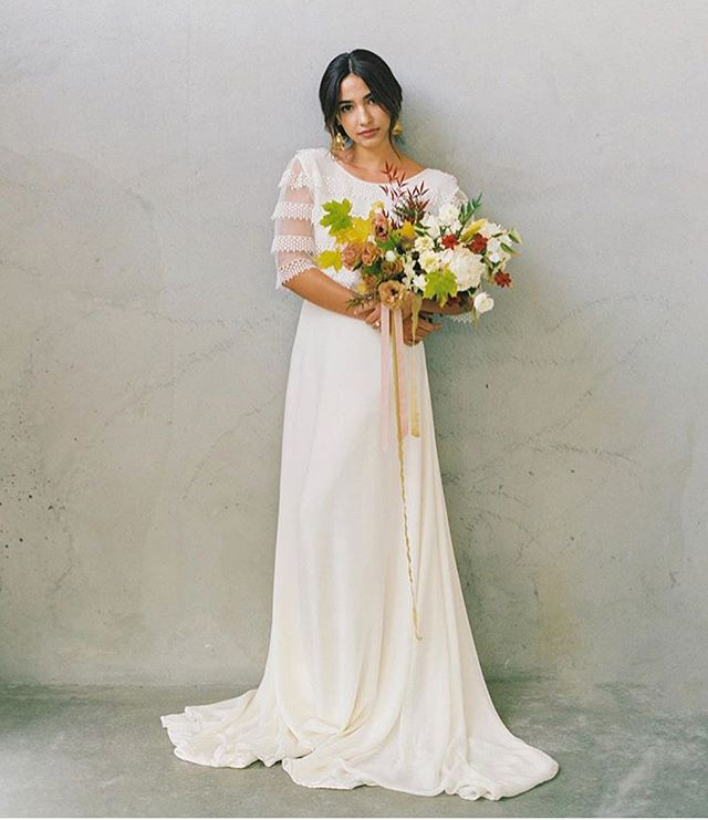 "STYLED SHOOT/EDITORIAL: Featured on @weddingsparrow today — the stunning ginkgo-inspired editorial, featuring our @donatellegodartparis ""Première du Monde"" gown! So much fall wedding inspo here, so be sure to click the link in our profile to see all the gorgeousness. And many 🙏 to the dream team who made it all possible // Photography: @cassievalentephoto 