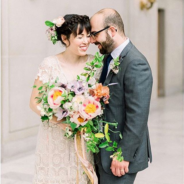 "There's nothing quite like a SF City Hall wedding — gives us all the feels every time. Our #REALALTBRIDE Erin was a total vision in her @kiteandbutterfly ""Anais"" gown. @pradonuts we wish you and your hubs and lifetime of love, laughter, and happiness 😘 // Photos by @aimi.photo 
