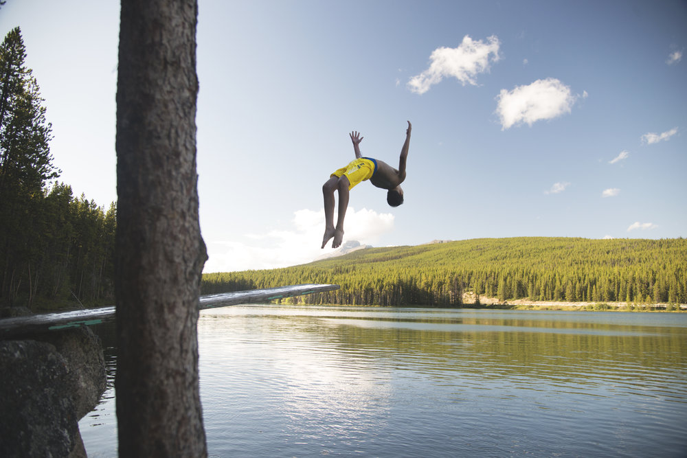 Joe Backflipping at Herbert Lake Diving Board in Alberta.jpg