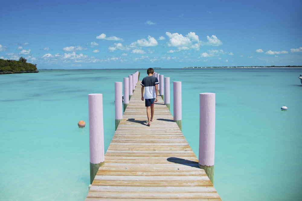 Noah Walking to the Bluest Water I've Seen in Bahamas.jpg