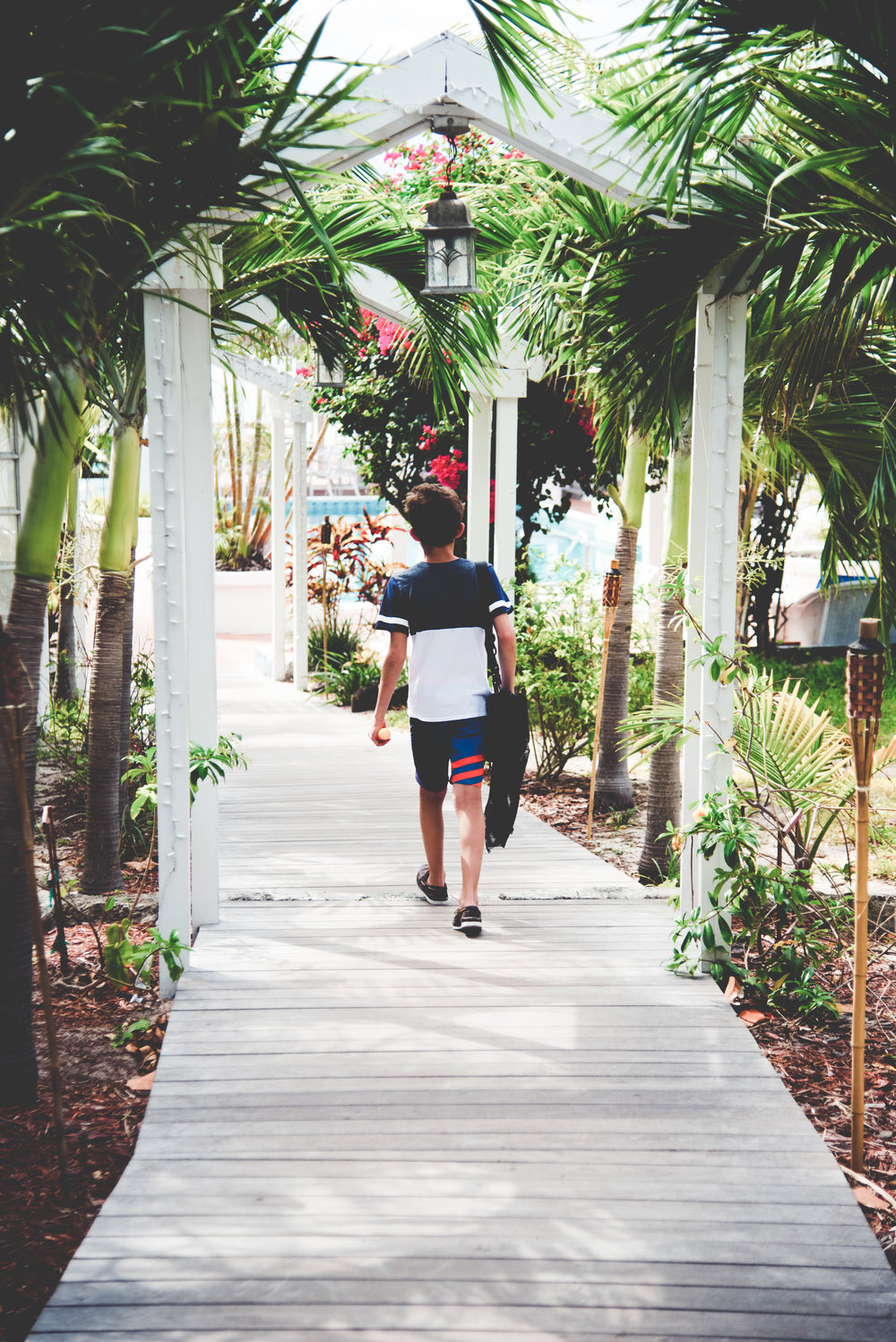 Noah Walking in Cool Path to Beach in Bahamas.jpg