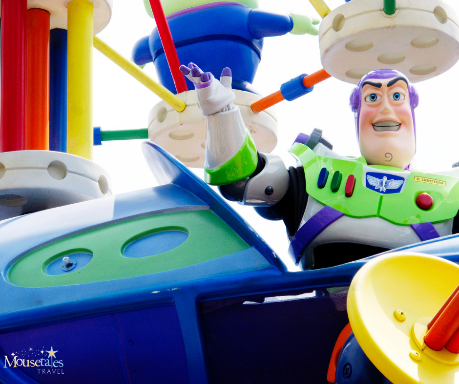 Buzz Lightyear waves from the Pixar Parade at Hollywood Studios