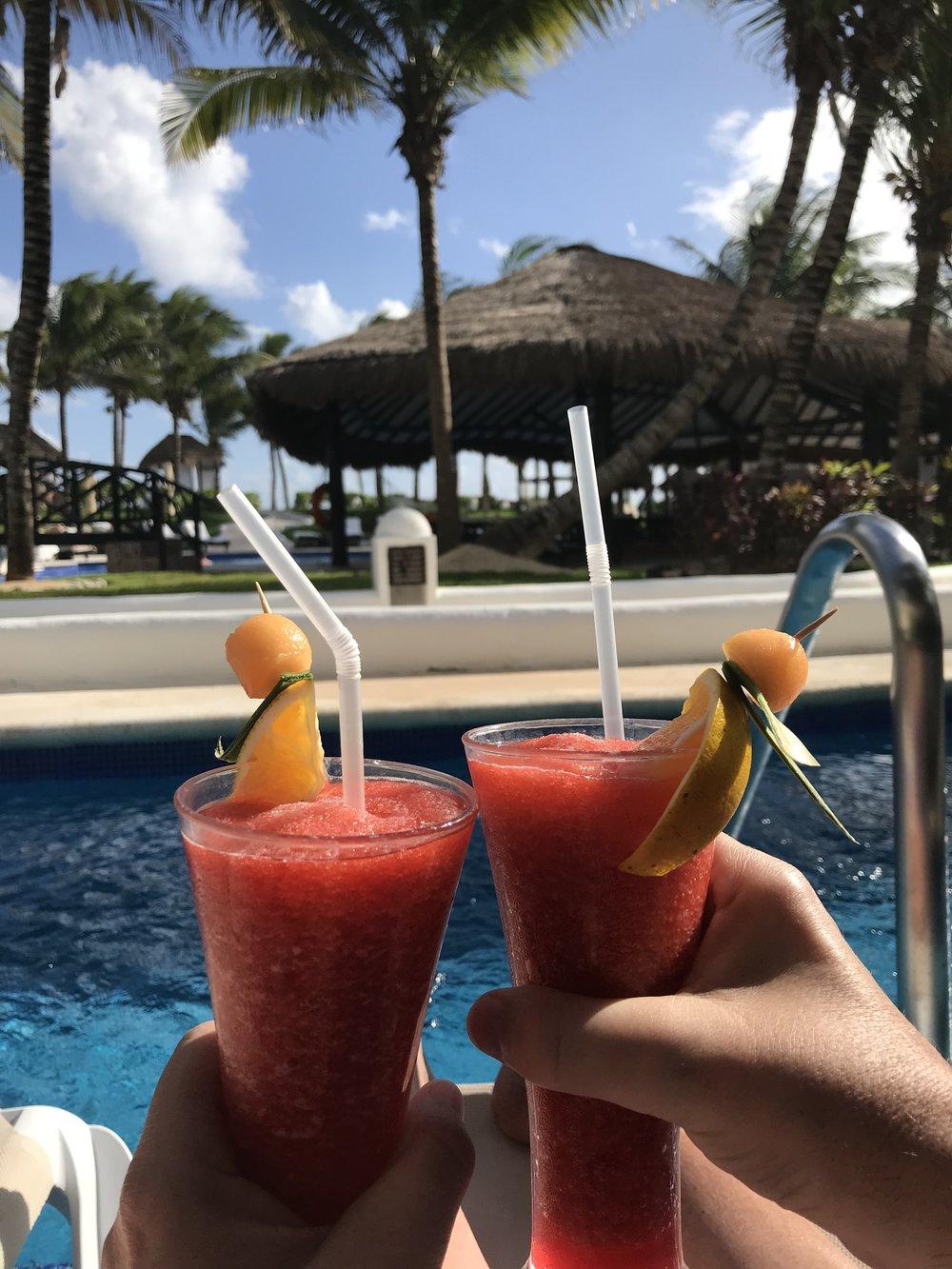 Strawberry Daquiris in our Swim Up Suite at El Dorado Casitas Royale, a Karisma Resort