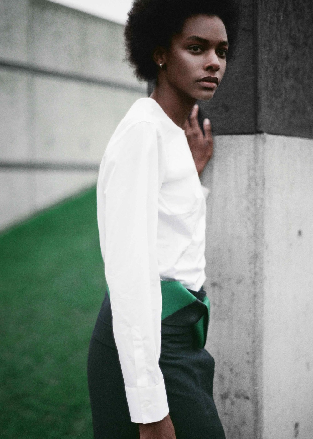 White cotton poplin shirt, cotton gabardine wrap skirt, navy and green leather belt, calf leather socks and sandals.