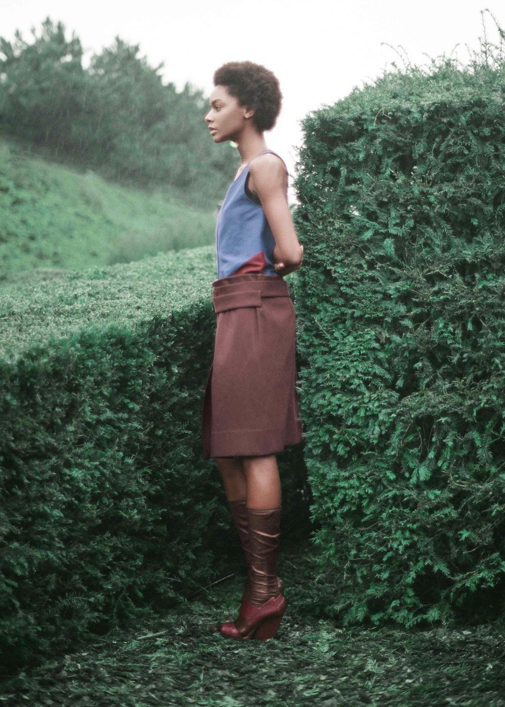Blue and brown cotton gabardine dress, calf leather socks and sandals.