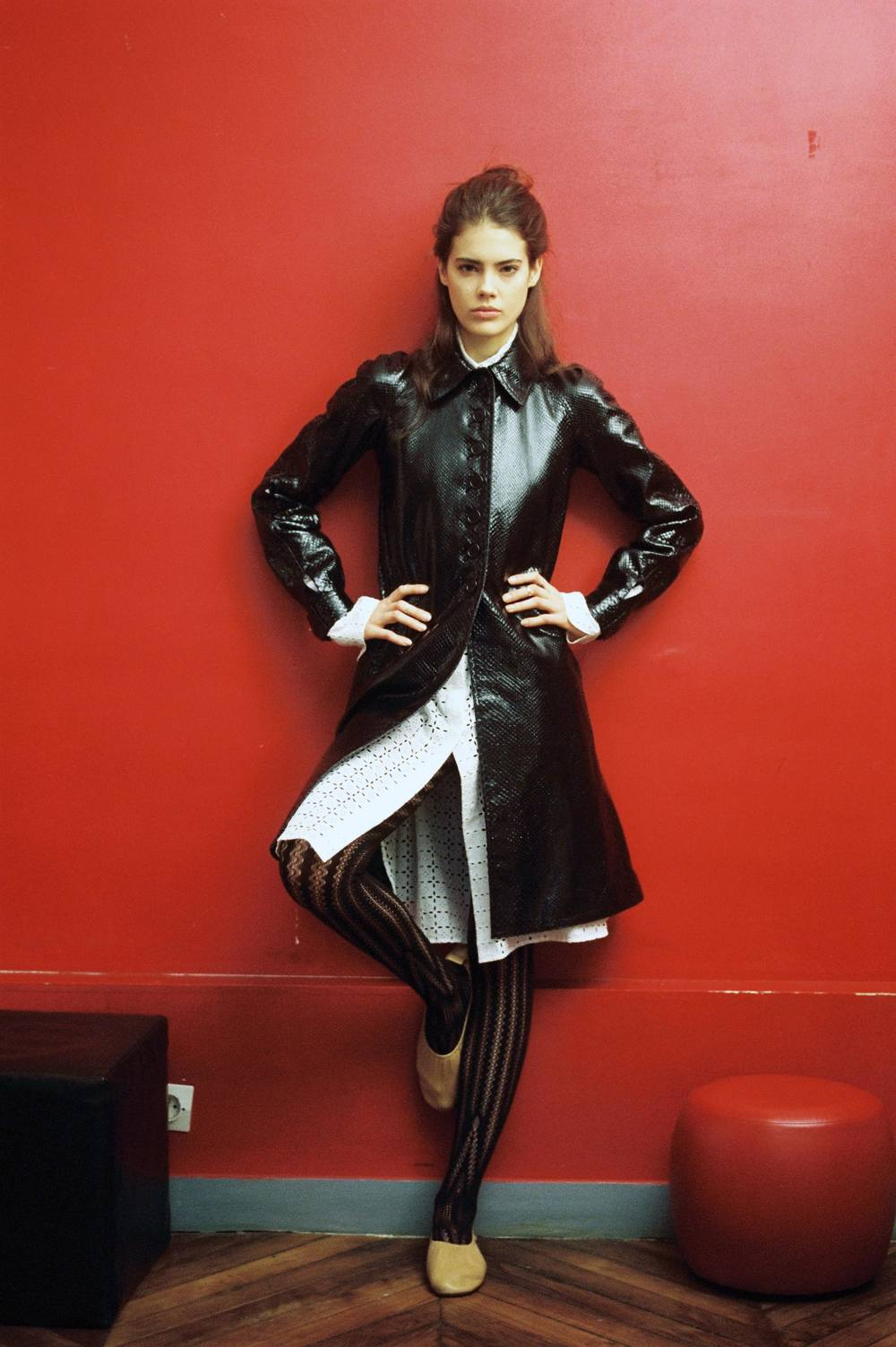 Python coat and anglaise broderie chemisier  ALAÏA,  tights  WOLFORD,  lambskin ballerinas  CÉLINE.