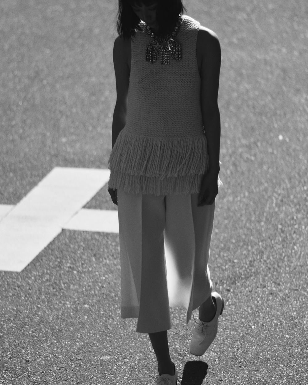 Wool fringed knit top and culottes, brass crystal necklace and stamped crocodile calfskin brogues  CÉLINE.