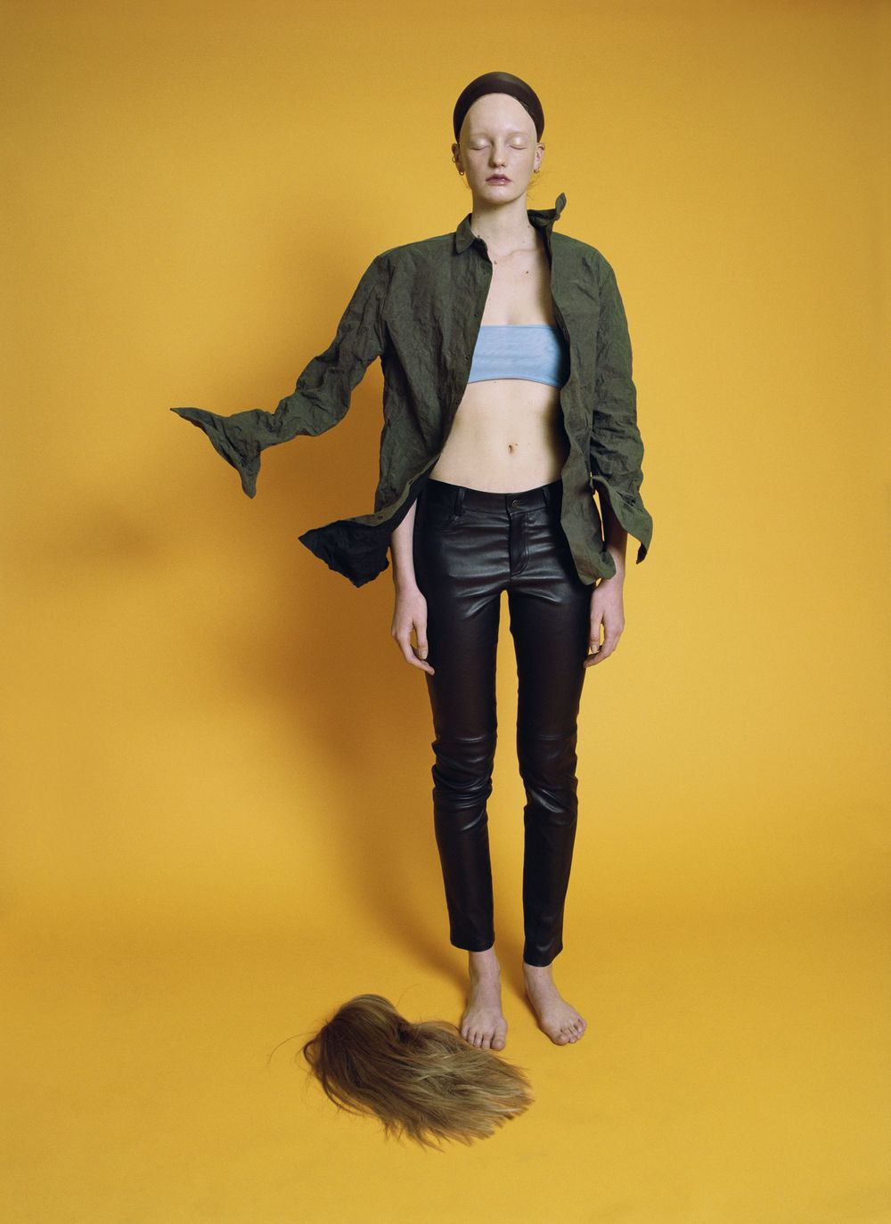 Metal cotton shirt  A.F. VANDEVORST,  powder blue fishnet band  LÉA PECKRE,  leather trousers  AGNÈS B.