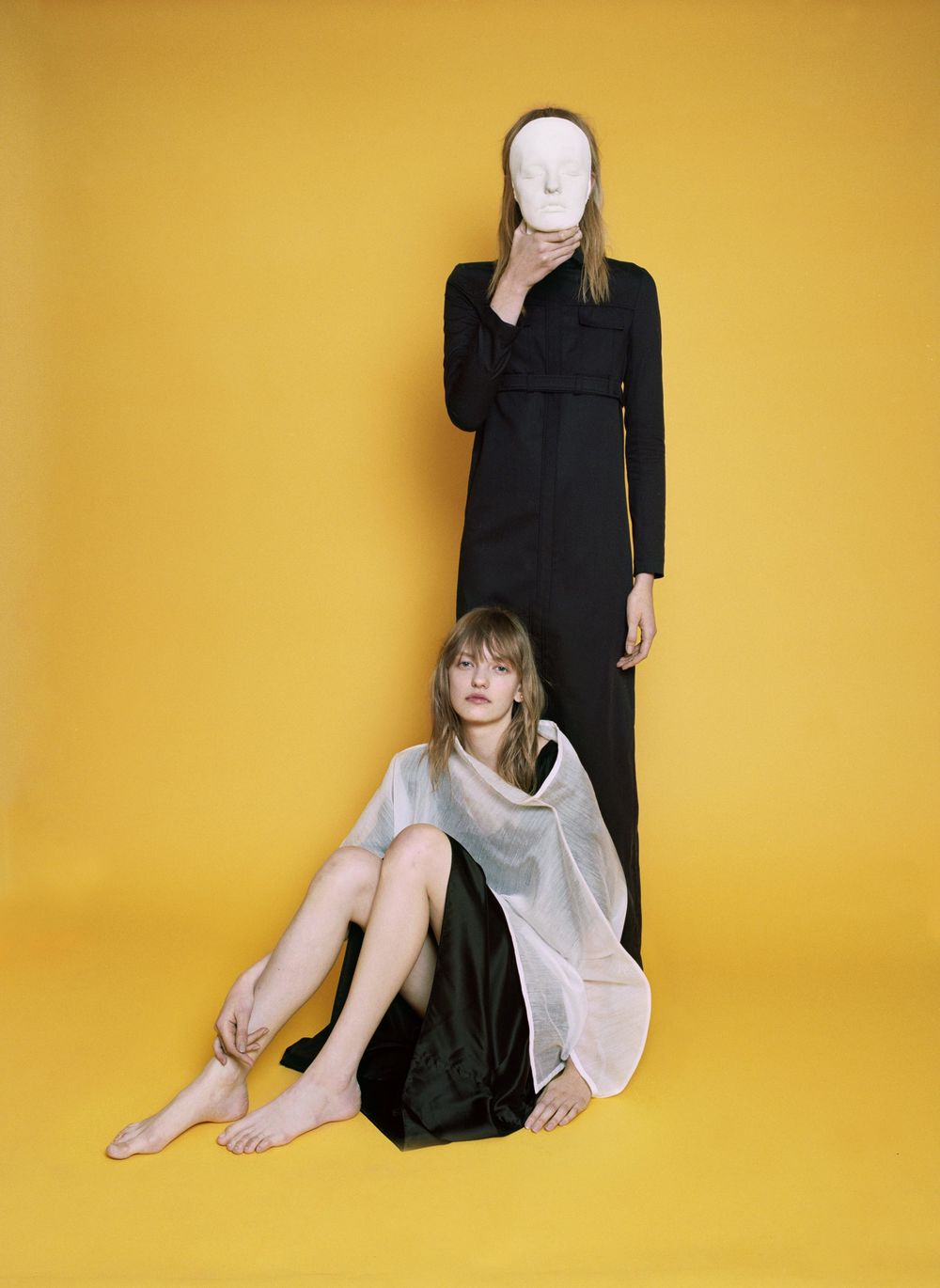 Black gabardine coat  LÉA PECKRE,  ramie and nylon sheer tunic  ISSEY MIYAKE,  black silk dress  BLESS.