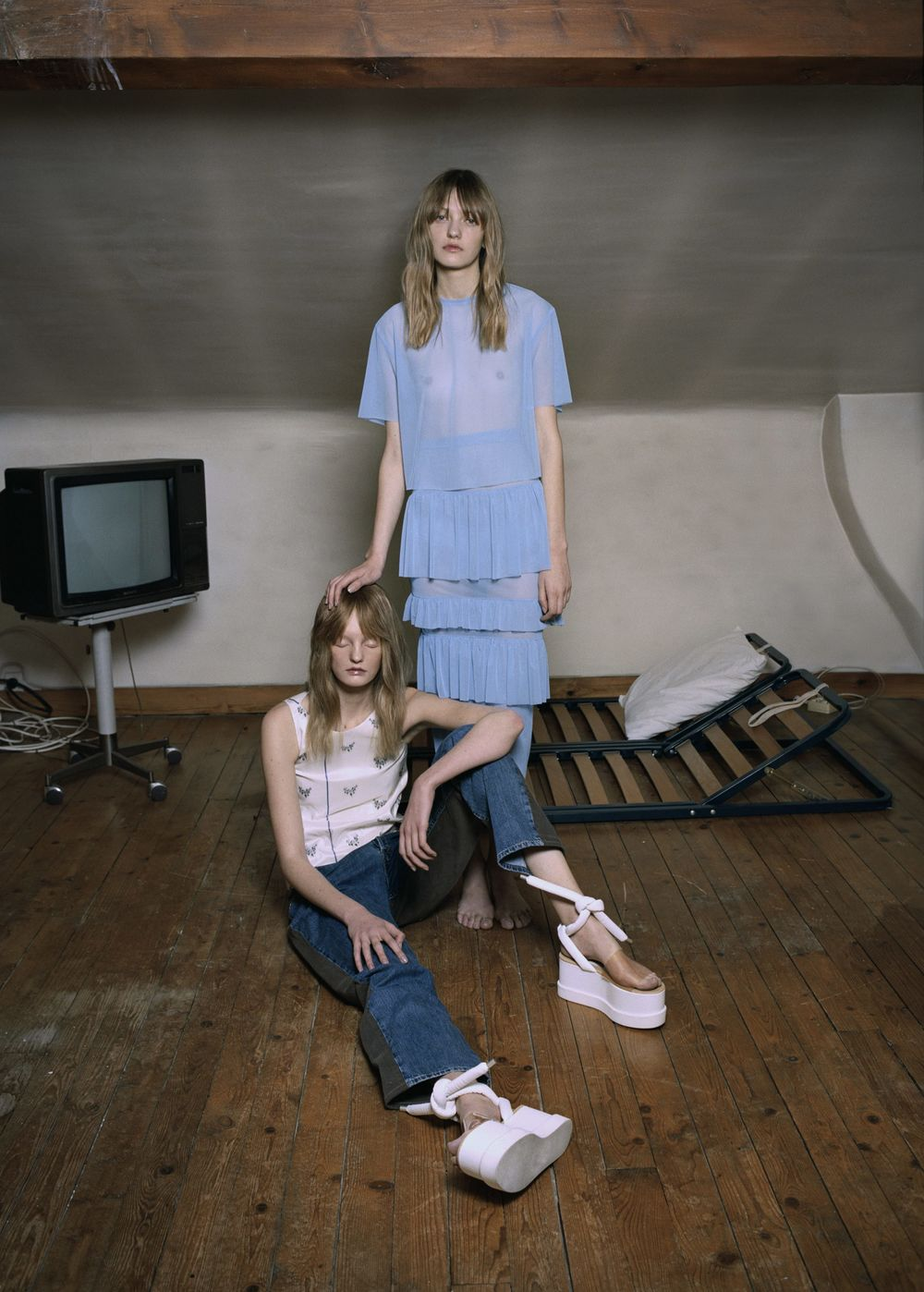 Powder blue fishnet ensemble  LÉA PECKRE,  floral print taffeta blouse  DIOR,  two-toned denim trousers  BLESS,  white wedges  MM6 MAISON MARTIN MARGIELA.