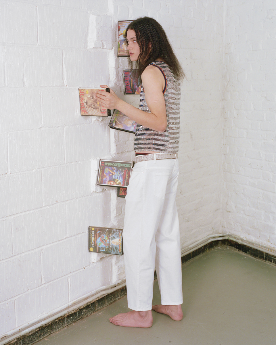 Stripe sequined and jersey tank top  ASHISH , straight-leg denim trousers  KENZO , leather and glitter belt vintage  MIU MIU .