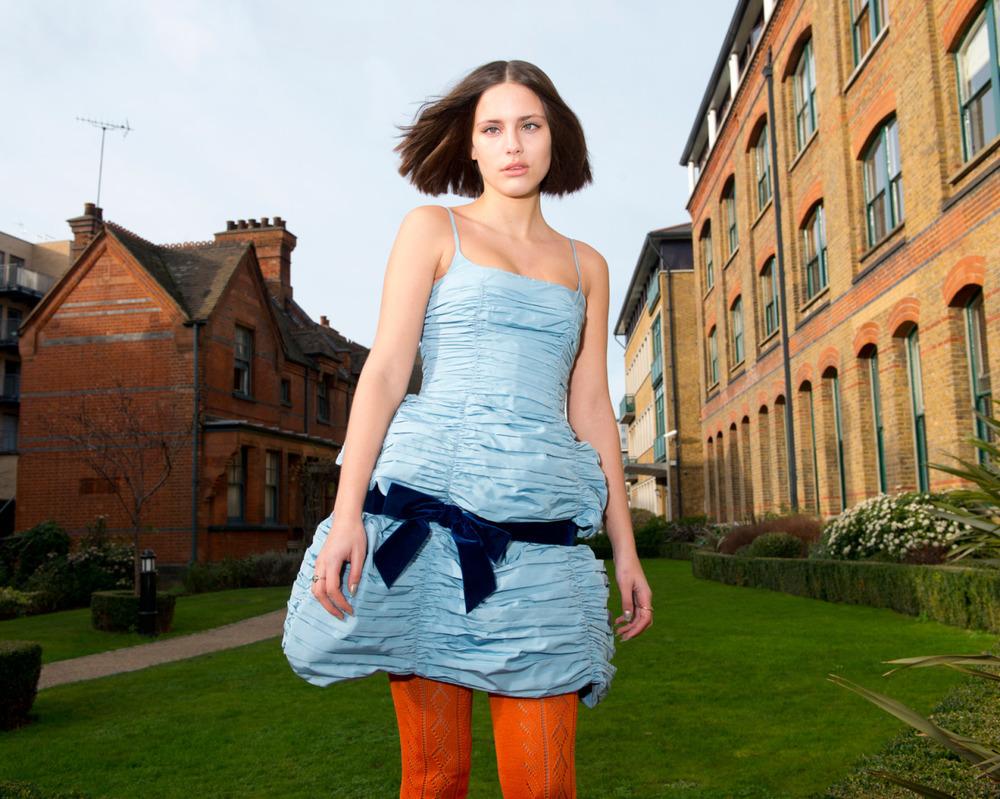 Silk faille draped dress and orange cotton tights  MIU MIU .