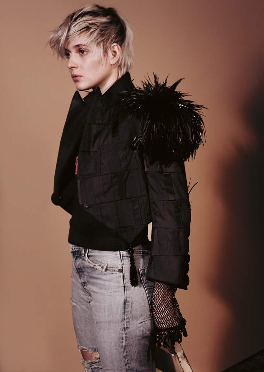Patchworked silk spencer jacket with feathered shoulders and jais embroidery, fishnet embroidered leggings worn as sleeves  LOUIS VUITTON , spritey ripped denim trousers  LEVI'S 501  Vintage stylists's own.