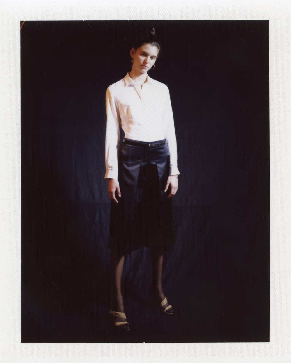 White shirt, black satin skirt. 18ct golden hoop and square earrings ATELIER VM, sandals MIU MIU at MADAME PAULINE VINTAGE, leather belt MAISON MARGIELA