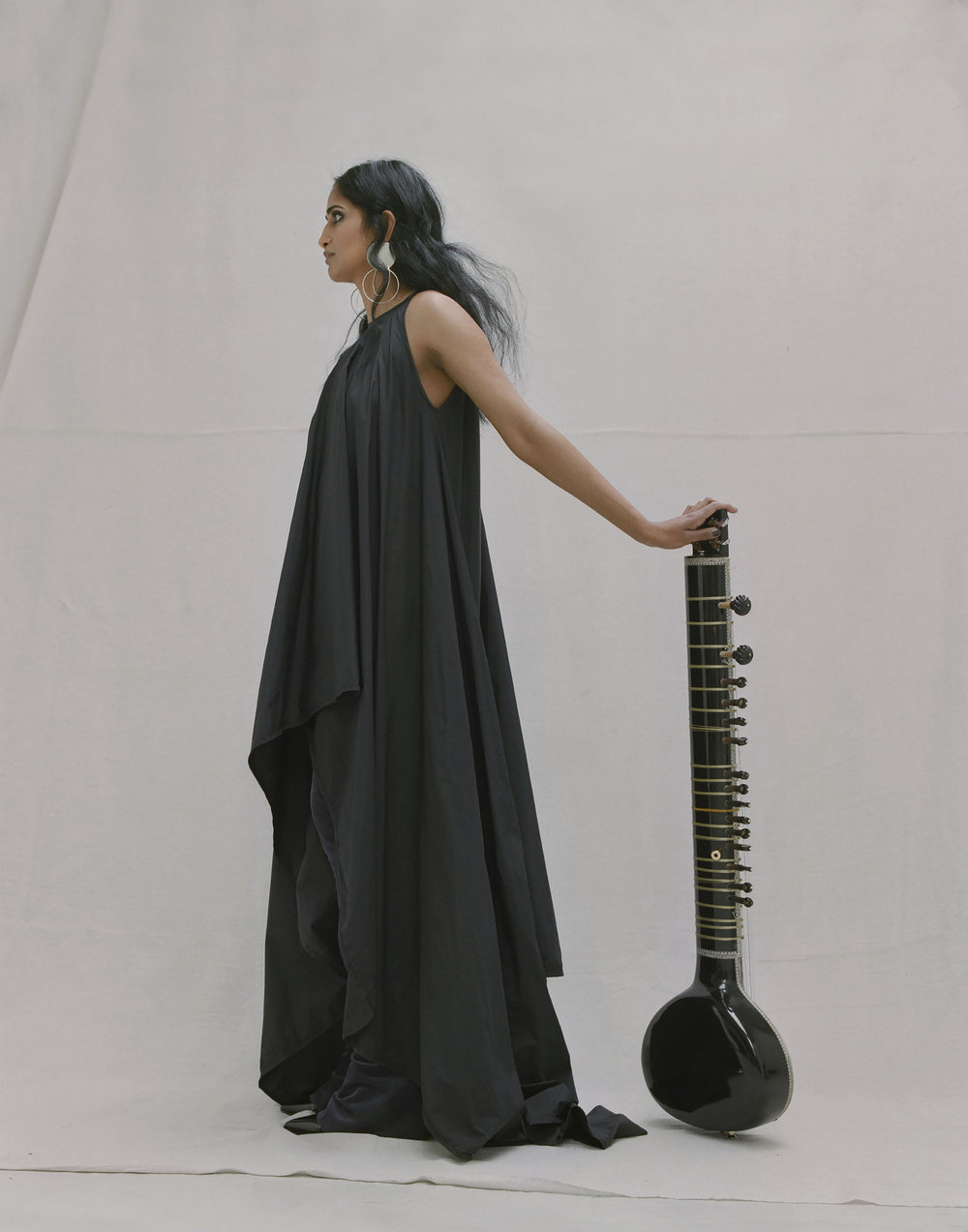 Asymmetrical long dress and trousers MICHAEL OLESTAD, black leather shoes PACO RABANNE, earrings ANNIE COSTELLO BROWN.