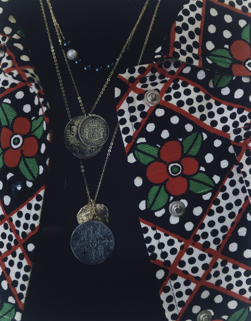 Coin necklace with midnight blue sapphire, and two coin set necklace both LAURA LEE JEWELLERY, black and white pearls necklace SWEETPEA JEWELLERY, floral printed jacket FRANCO JACASSI VINTAGE DELIRIUM, black stitched turtleneck PRADA.
