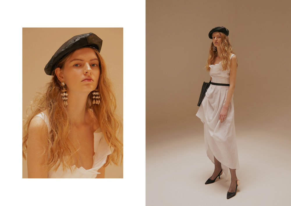 White dress Isabel Benenato, chandelier earrings Sharra Pagano, belted bag Lucio Vanotti, vintage hat Moschino, collant Maria La Rosa, slingback Sebastian