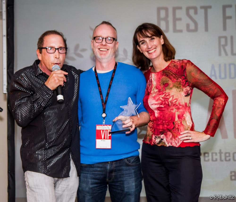 Mark Gilbert presenting award to Brian O'Donnell and Ellen Kollar (photo credit: RADskillZ)
