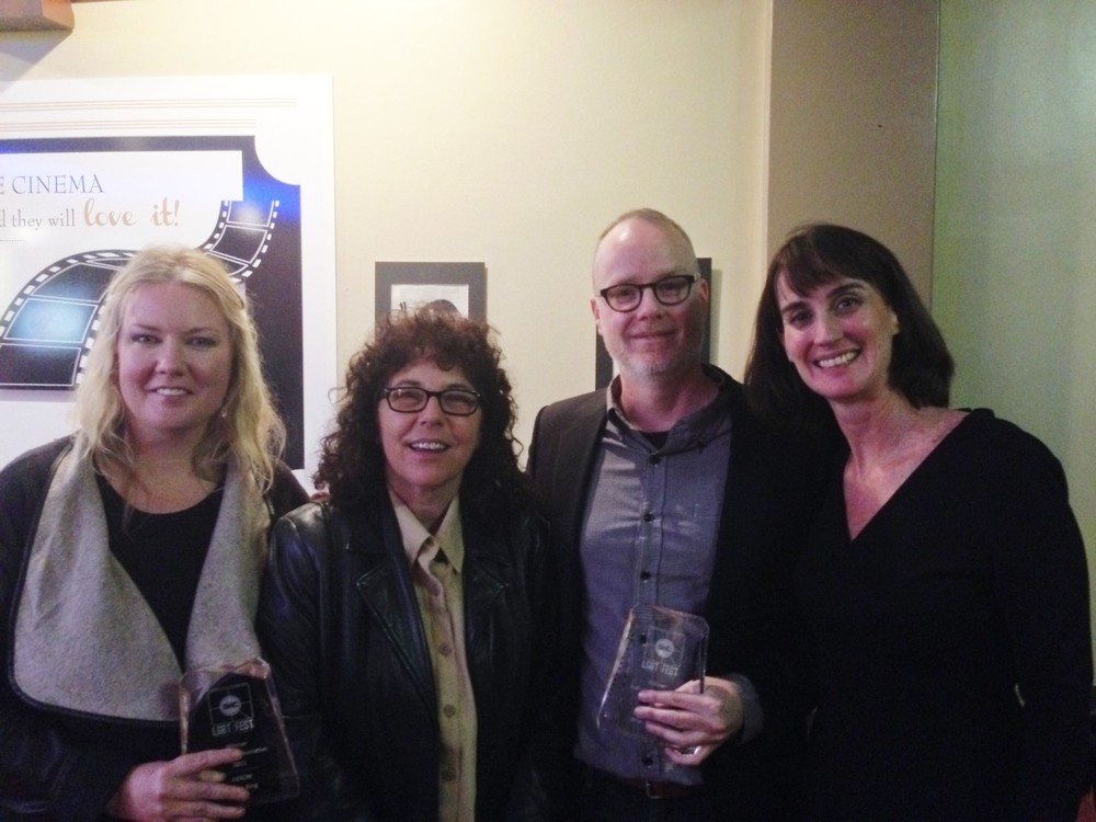 Sasha King and Brian O'Donnell with their Best LGBT Narrative Film Awards, with Lori Gum and Ellen Kollar