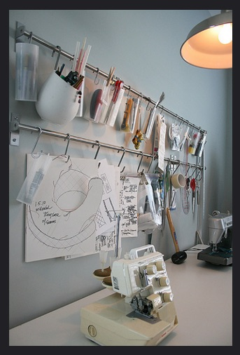 Love this industrial hanging system for keeping supplies and sketches close by.