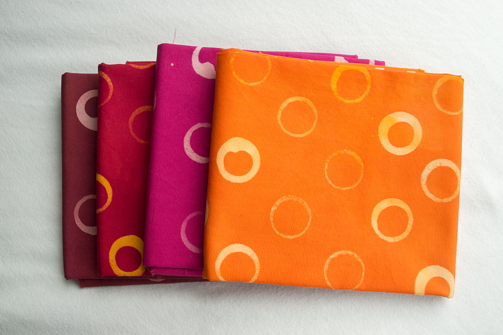 Warm bundle features shades of orange, red, pomegranate, and fuchsia.