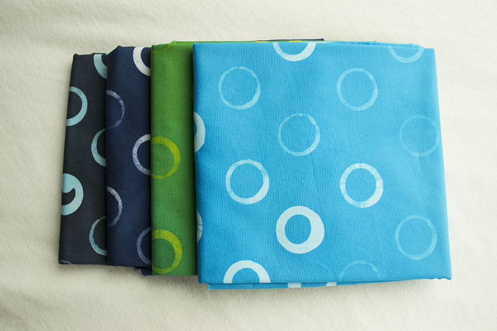 The cool bundle includes turquoise, grass green, grey, and indigo.
