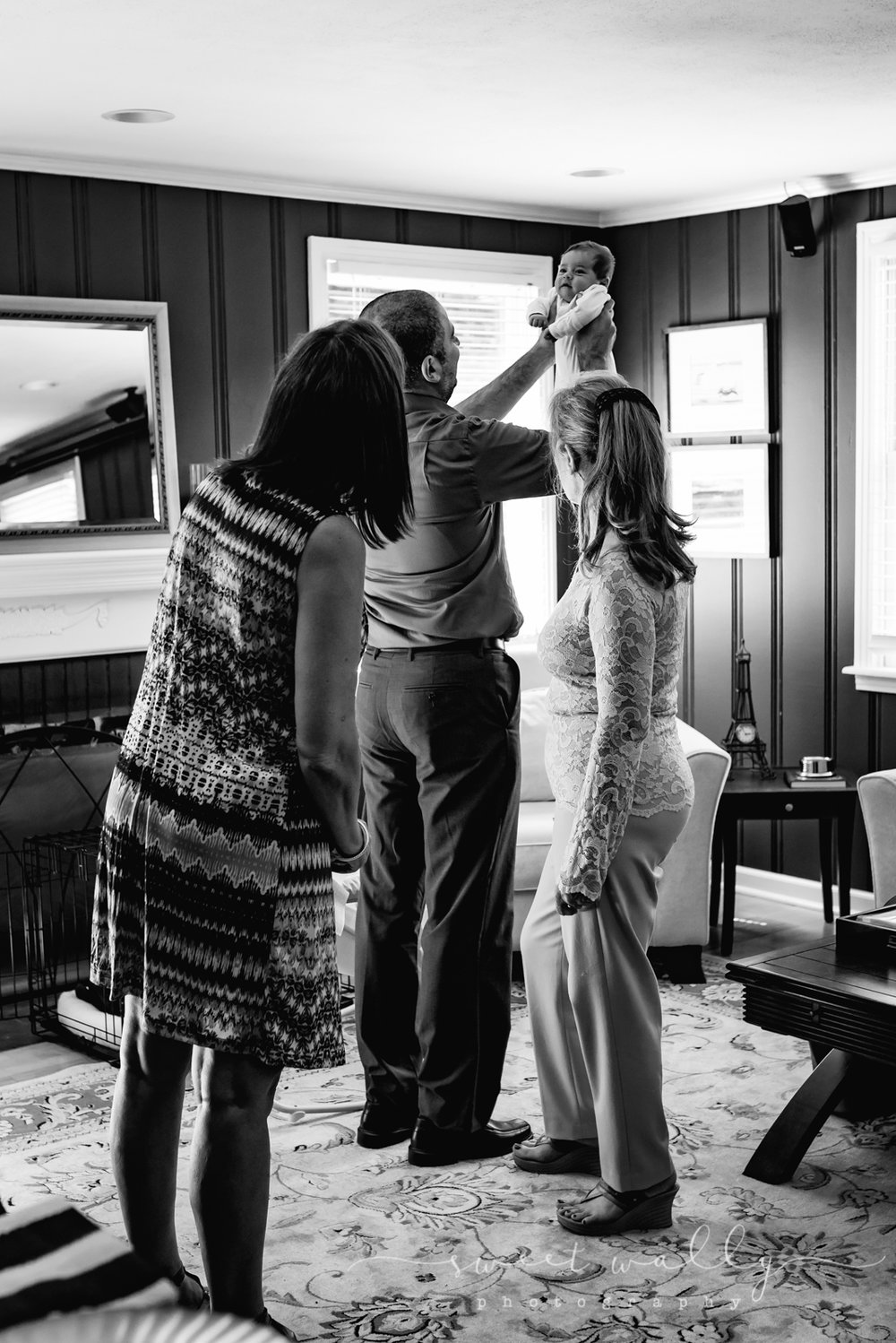 Admiring the guest of honor | Christening Photography by Sweet Wally Photography | Nashville Newborn Photographer