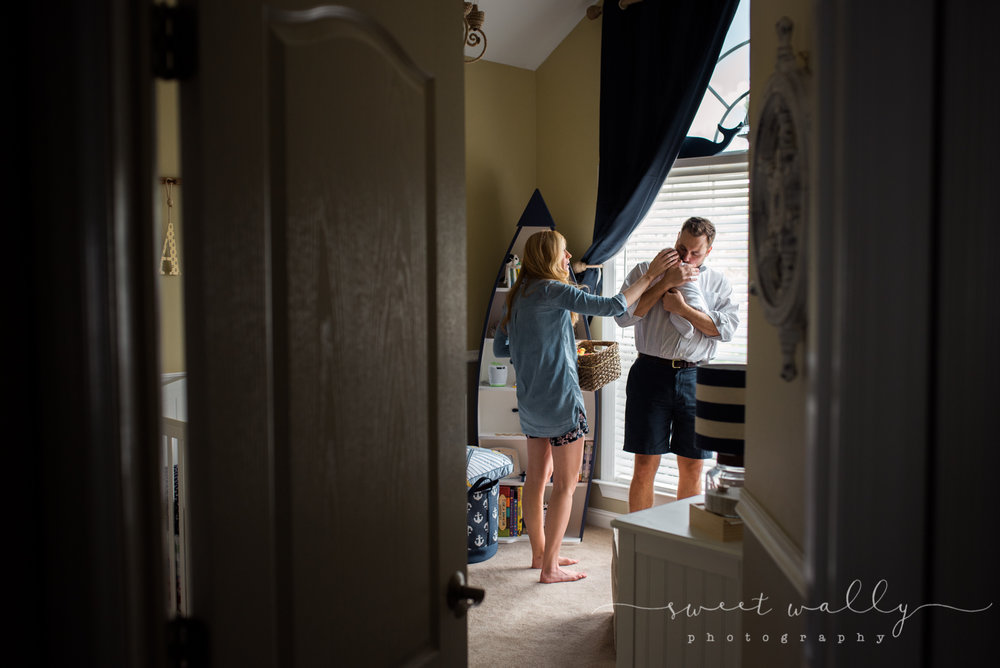 Candid moments during an in-home newborn session | Lifestyle Newborn Photography by Sweet Wally Photography | Nashville, TN