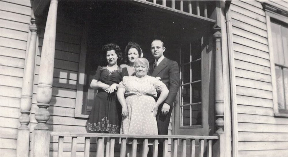 "The Americanized ""Frank"" Family, of Italian heritage, standing proudly on the front porch of their Erskine street home, ca. 1950"