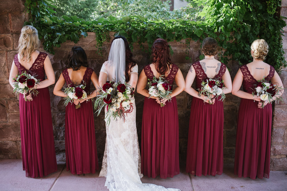 bridal party photos, flowers behind the back