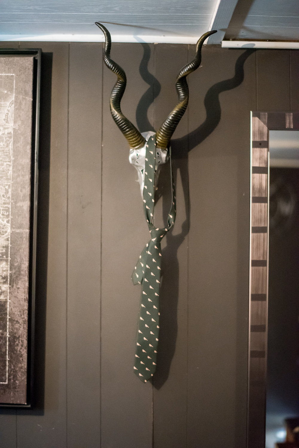 cool antler piece in grooms ready room | Kelly Birch Wedding Photography in Minnesota