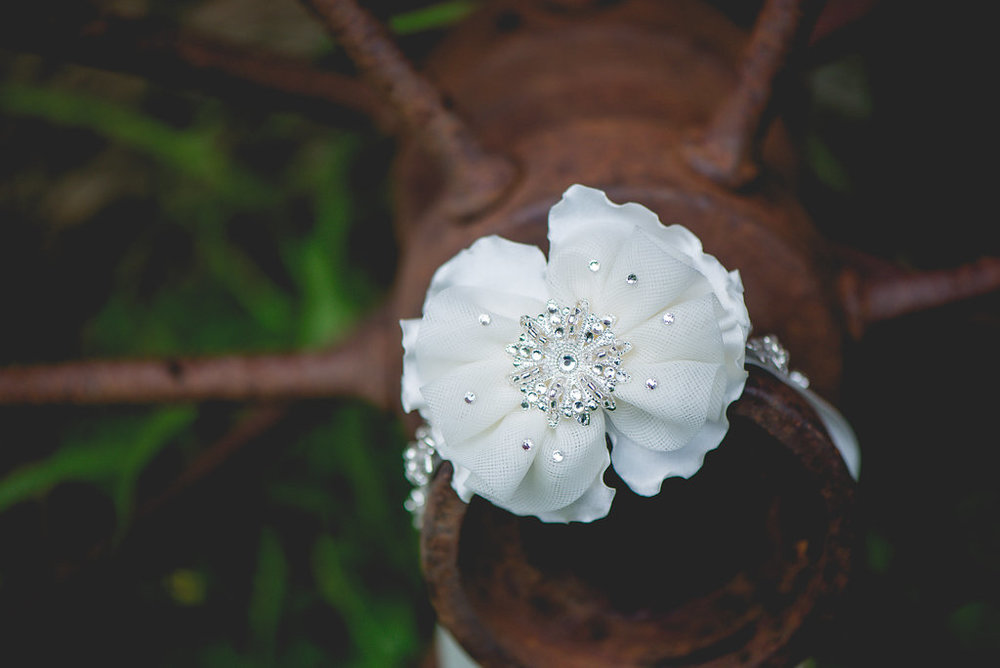 white flower wedding garter with jewels and rhinestones | Kelly Birch Photography