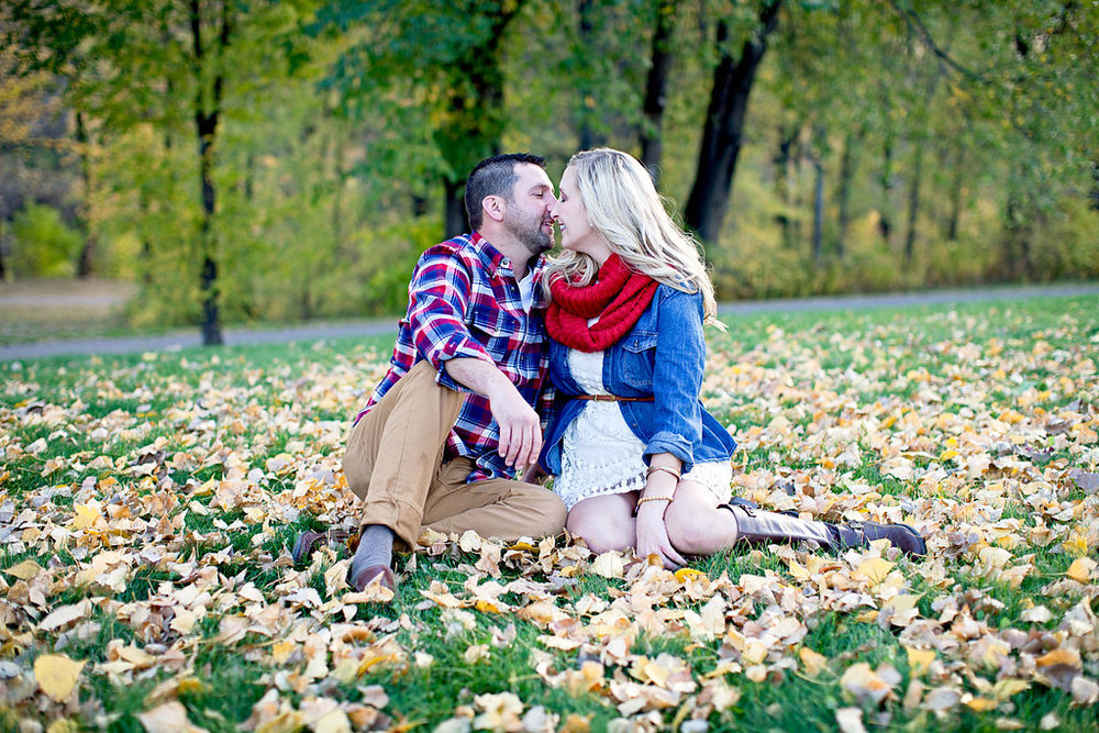 Fall leaves engagement | white dress with denim shirt and brown belt boots, red scarf | red white blue plaid shirt with khakis | photo by Ashley Elwill Photography Minneapolis wedding photographer