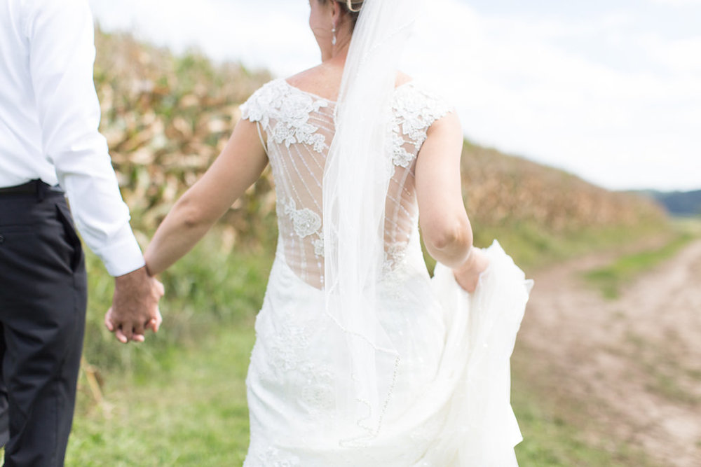 beaded lace and see through back wedding dress with long veil | walking in the corn fields | Ashley Elwill Minneapolis Wedding Photographer