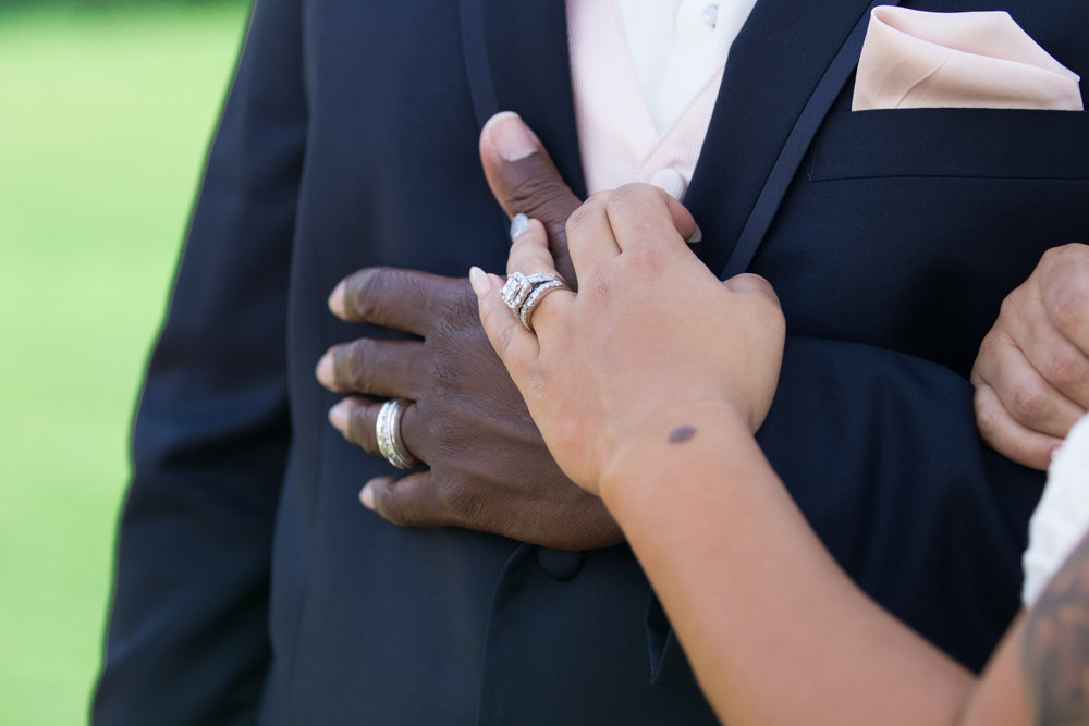 Bride and groom wedding ring, hands on his chest photo | Image from Tigerlily Photography