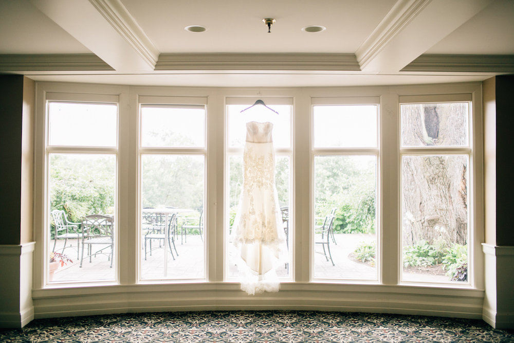 Dress hanging in the window | Wayzata Country Club | Mark Fierst Photography | Acowsay Cinema | Sixpence Standard blog post
