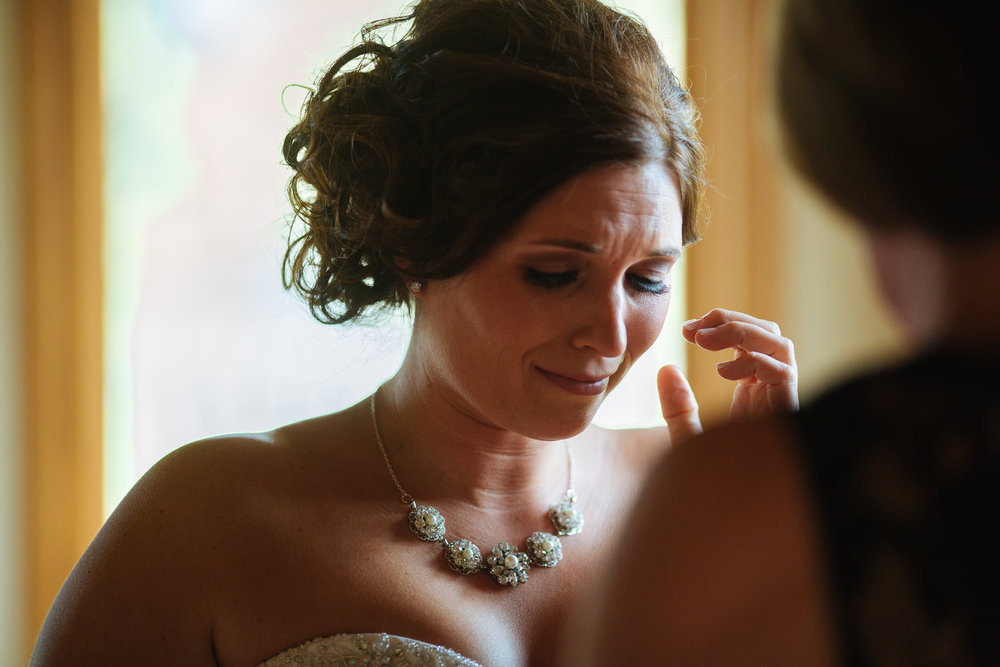 Alyssa Lee Photography | Bride getting ready, teary-eyed | Sixpence Standard Blog